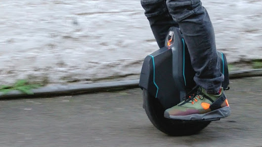 Riders try out British-made electric unicycle - BBC News