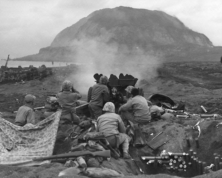 US Marine 37mm gun firing on Japanese positions on the northern slope of Mt. Suribachi, Iwo Jima in support of RCT 28, 21 Feb 1945