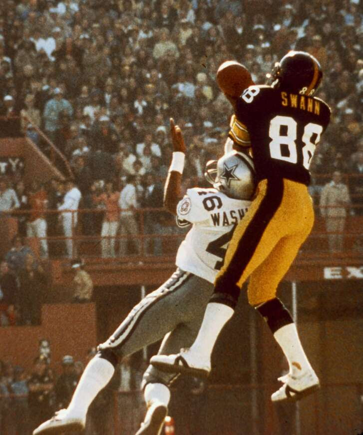 Pittsburgh Steelers wide receiver Lynn Swann goes up to make a ,catch over Dallas Cowboys cornerback Mark Washington in the Steelers 21-17 win over the Cowboys in Super Bowl X on January 18, 1976 at the Orange Bowl in Miami, Florida. (AP Photo/NFL Photos)