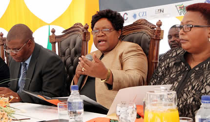 Zimbabwe Vice President Joice Mujuru addresses delegates at the ZITF International Business Conference in Bulawayo on April 24, 2013. She is flanked by Industry and Commerce Minister Welshman Ncube (left) and Deputy Prime Minister Thokozani Khupe. by Pan-African News Wire File Photos