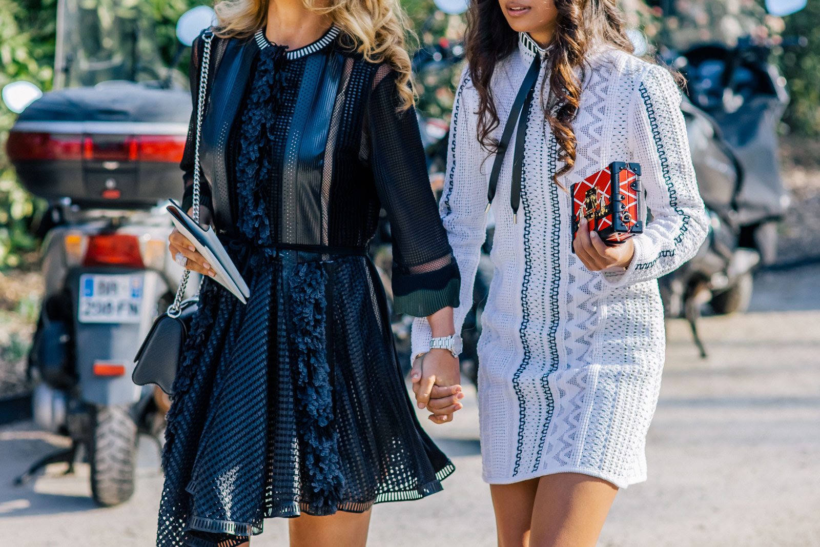 Women wearing Louis Vuitton outfits before the Louis Vuitton Fall/Winter 2015-2016 fashion show in Paris, France