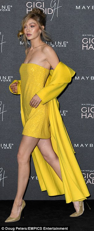Woman of the hour:The brunette beauty certainly took centre-stage in her Nineties-inspired strapless yellow dress, which featured decadent all-over beading
