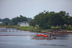An American Pollution Control boat carries mor...