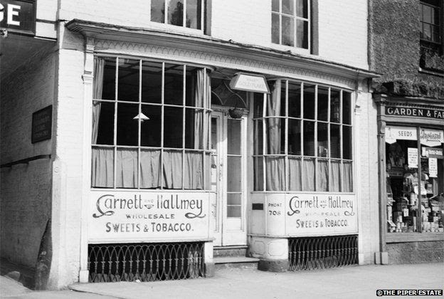 Photograph of shop front of Garnett and Hallmey, possibly in Derbyshire