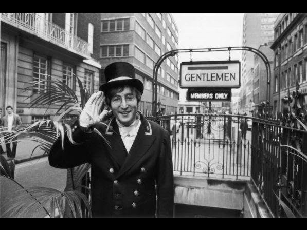 27th November 1966: British rock musician and member of The Beatles John Lennon (1940 ­ 1980), dressed as a Public Lavatory Commissionaire during the filming of the 'Not Only...But Also' Christmas Special, starring Peter Cook and Dudley Moore. He is outside a public convenience near Berwick Street, in London's Soho.