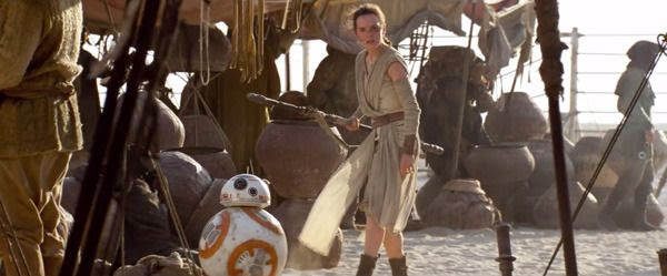 Rey (Daisy Ridley) and BB-8 keep on the lookout for trouble in a Jakku village in STAR WARS: THE FORCE AWAKENS.