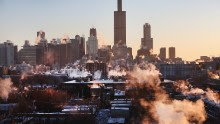 CHICAGO, IL - JANUARY 28:  The sun rises behind the skyline as temperatures hovered around -10 degrees January 28, 2014 in Chicago, Illinois. The city has had 18 days at or below zero so far this winter, two shy of the 20-day record.  (Photo by Scott Olson/Getty Images)