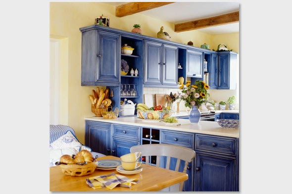 Husker dream homes brighten your kitchen with color for Blue kitchen cabinets with yellow walls
