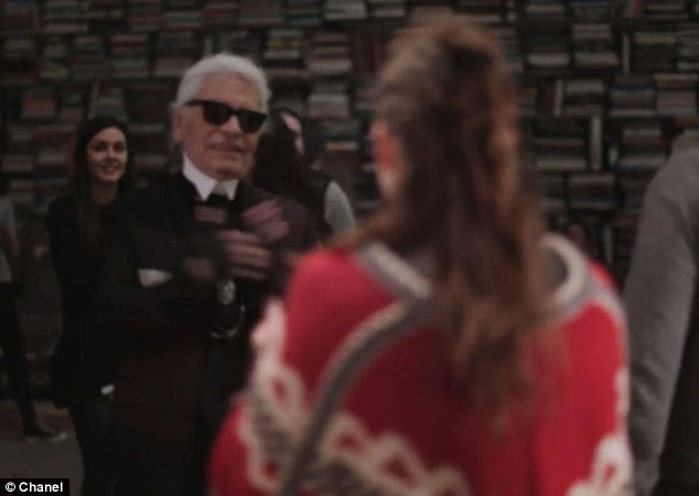 Star attraction: Lagerfeld looks adoringly at his favourite pop culture icon