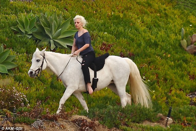 Ride time! Lady Gaga took her white horse she received in December for a ride on Thursday in Malibu