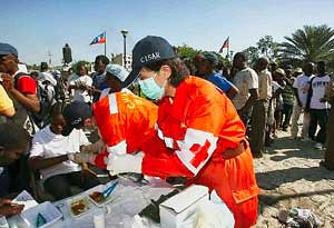A medical aid worker from the People's Republic of China performing duties in a camp in the Caribbean nation of Haiti. The nation was struck by a 7.0 earthquake on January 12, 2010. by Pan-African News Wire File Photos