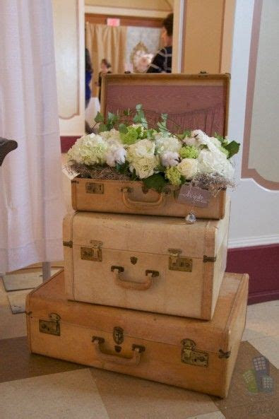 vintage suitcases with flowers   Centerpieces, Table Ideas