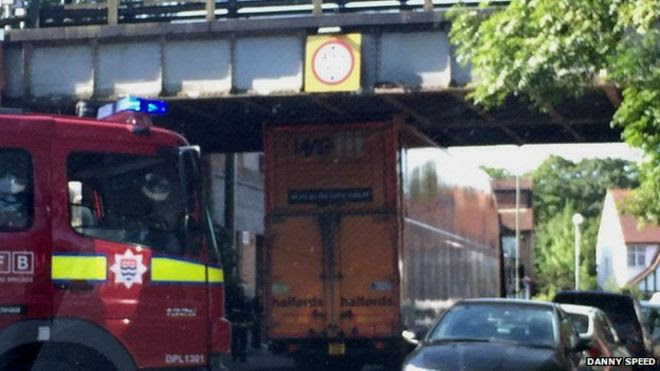 The Halfords lorry stuck under the bridge