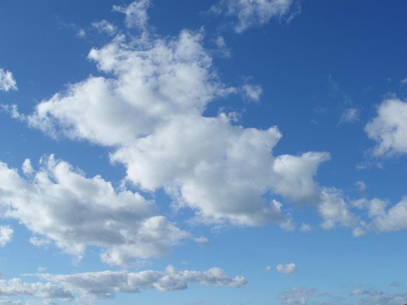 a blue sky with white fluffy clouds