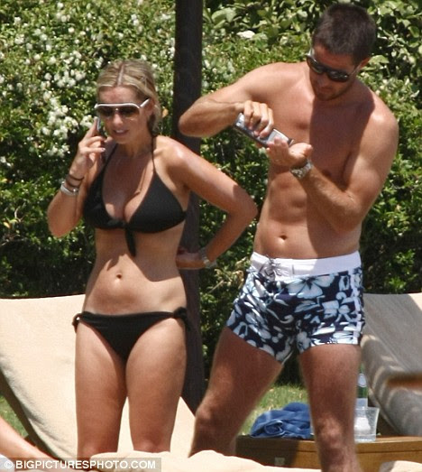 Footballer Jamie Redknapp and wife Louise soak up some rays whilst on holiday together in Italy
