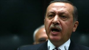 Turkey's Prime Minister Recep Tayyip Erdogan addresses members of his AK Party at the parliament in Ankara, 15 November.