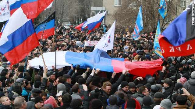 Pro-Russian activists hold Russian flags during a rally in the center of Donetsk, Ukraine, on March 1.
