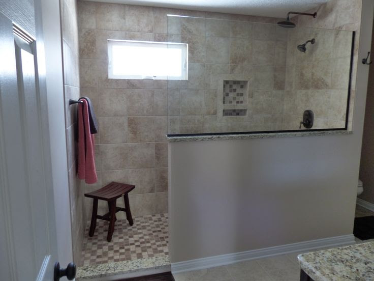 doorless shower area with wood bench and black metal hang kit two units of shower sprayers