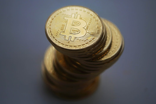 Bitcoin Plunges, Rebounds After Hackers Steal $65 Million
