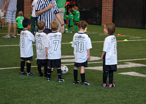 Kindergarteners playing soccer