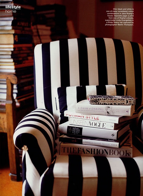 Wouldn't mind curling up in this chair with a stack of fashion books! #stripes #chair #books #blackandwhite