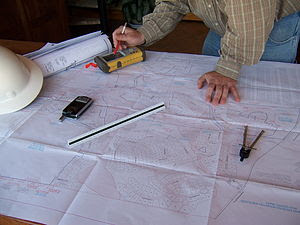English: Al Bordeau Reviewing Plansets. Is thi...