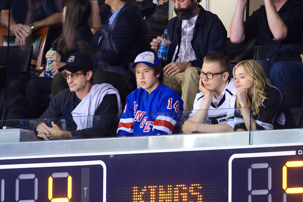 Chloe Grace Moretz (L-R)  Dermot Mulroney, Clyde Mulroney, Ethan Moretz and Chloe Moretz attend a hockey game between the New York Rangers and the Los Angeles Kings in Game Two of the 2014 NHL Stanley Cup Final at the Staples Center on June 7, 2014 in Los Angeles, California.