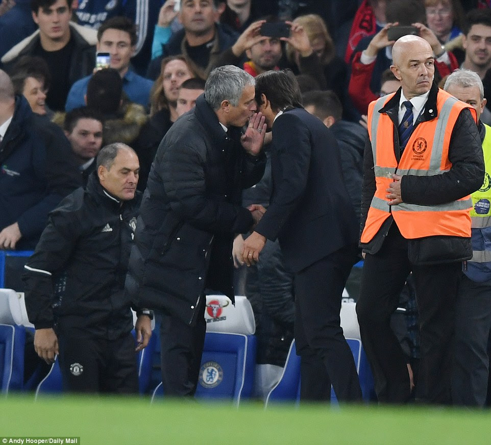 United boss Jose Mourinho has words with his Chelsea counterpart Conte after the final whistle is blown
