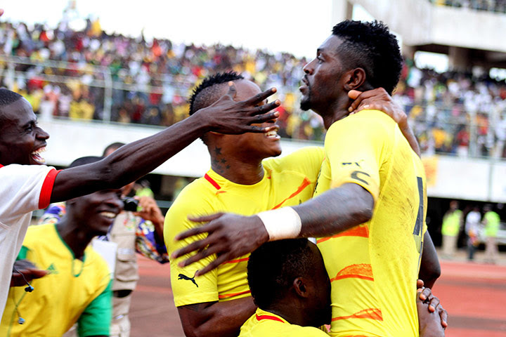 African Nations: Togolese's striker Emmanuel Adebayor is congratulated after scoring