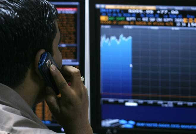Sensex trades on a flat note, Nifty holds 7,000 ahead of Budget 2016; ITC top loser
