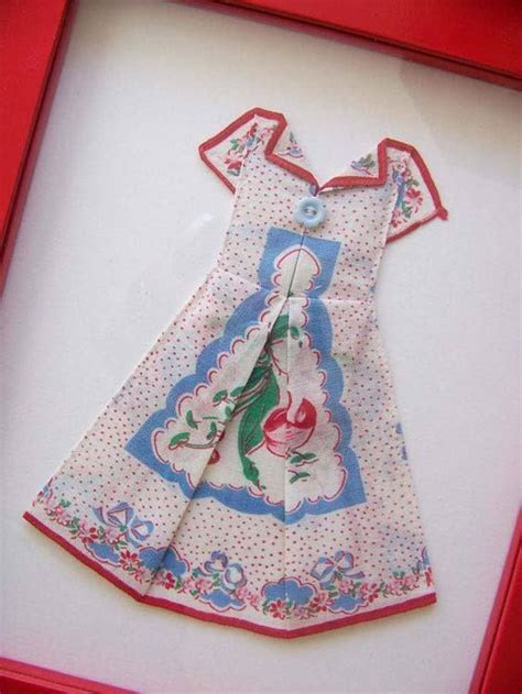 Folding a handkerchief to make a dress.   applique quilts