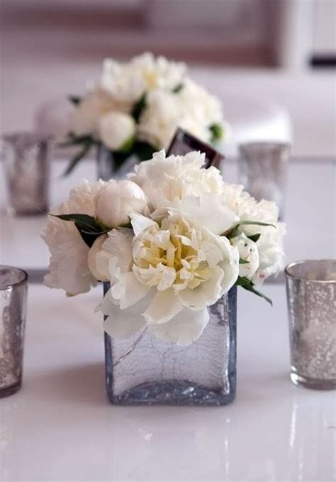 simple peony centerpieces with votives. love the mercury