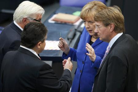 German Chancellor and leader of the Christian Democratic Union (CDU) Angela Merkel talks with Sigmar Gabriel (2nd L) leader of the Social Democratic Party (SPD) SPD parliamentary floor leader Frank-Walter Steinmeier (L) and Federal Chancellery Minister Ronald Pofalla (R) prior to a constitutional meeting of the Bundestag, Germany's lower house of parliament, in Berlin October 22, 2013. REUTERS/Fabrizio Bensch