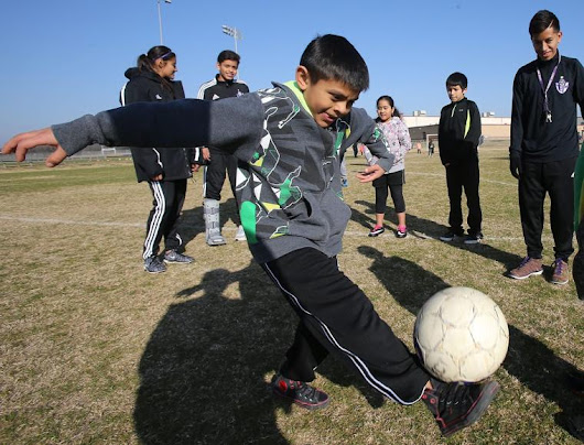 Soccer Buddies learn about positive character, soccer skills