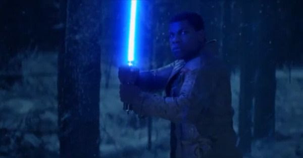 Igniting the lightsaber that once belonged to Anakin Skywalker, Finn (John Boyega) prepares to take on Kylo Ren (off-screen) in STAR WARS: THE FORCE AWAKENS.