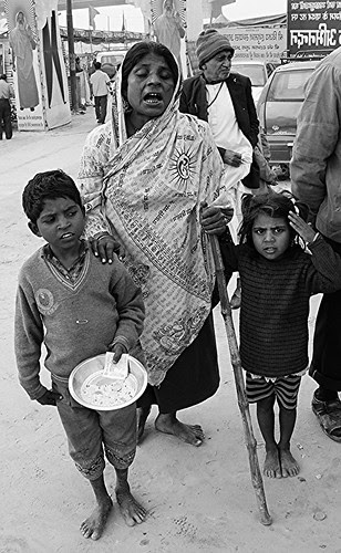 The Plight of Beggars At The Maha Kumbh by firoze shakir photographerno1