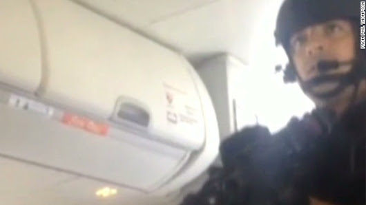 Video shows SWAT team storming a plane after mid-flight bomb threat
