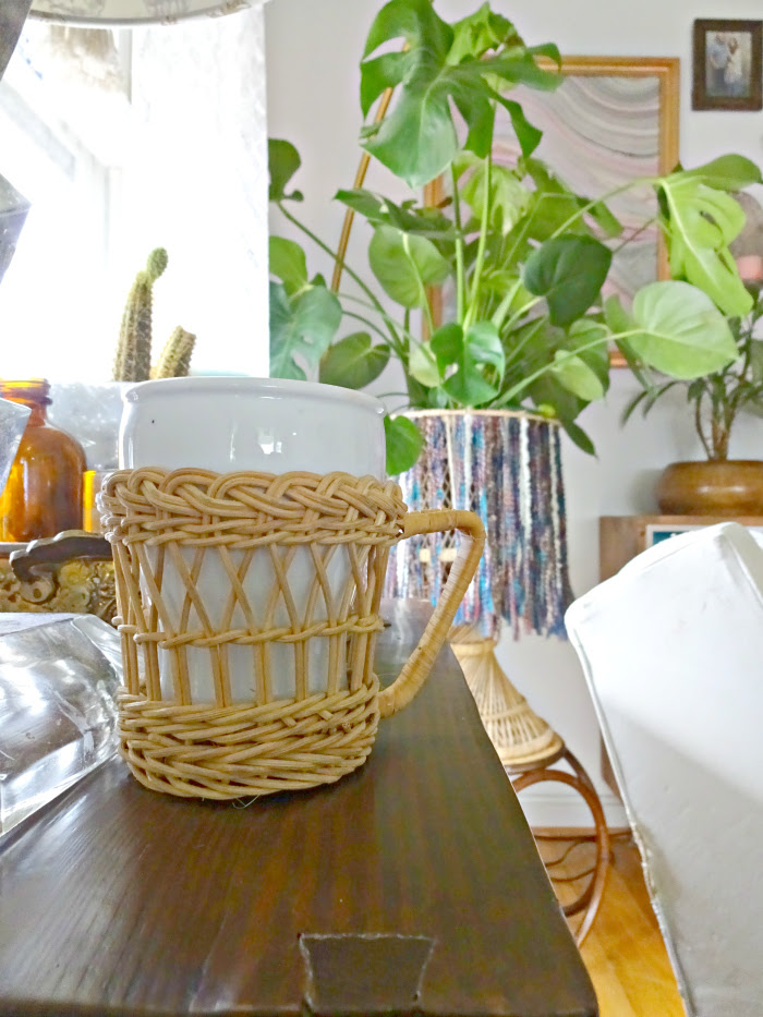 a cup of coffee and a split leaf philodendron, the perfect living room set up