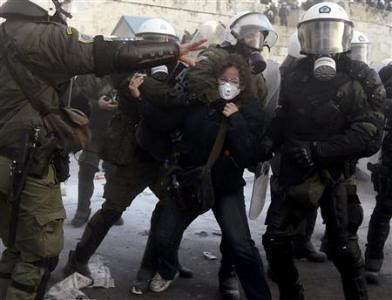 Greek riot cops tackle demonstrator amid the adoption by parliament of new austerity measures. The bankers have strangled the working class and poor in the European states. by Pan-African News Wire File Photos