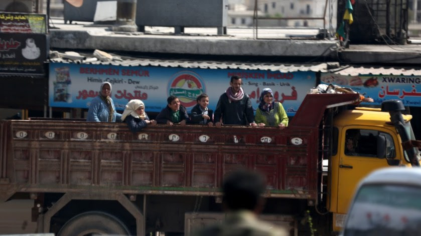 Civilians carry their belongings at the recently captured city of Afrin, Syria, 19 March 2018. EPA, AREF TAMMAWI
