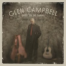 "The album cover features Campbell wearing a long black coat standing with an open guitar case to his right and an acoustic guitar to his right. Above him are the words ""GLEN CAMPBELL / GHOST ON THE CANVAS"" written in white."