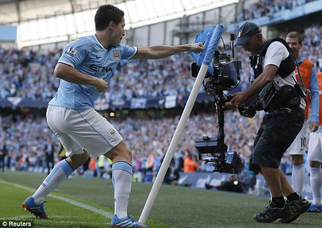 Punch perfect: Nasri hits the corner flag in celebration