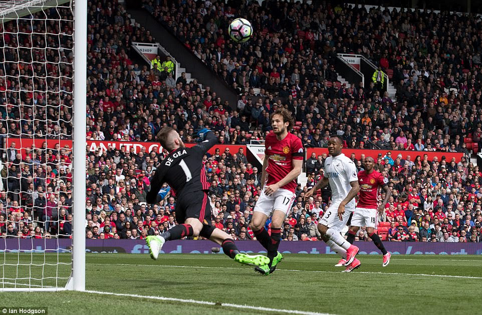 David de Gea makes a strong save to keep out a shot from the visitors as Swansea rattled United after Shaw's substitution