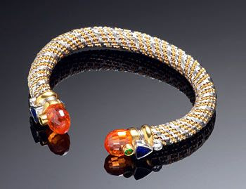 pessartite garnet briolettes on the ends of a gold and platinum woven bracelet by T. Lee.