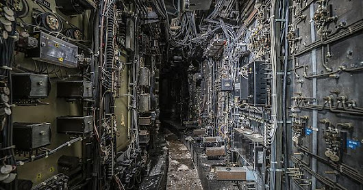 Computer wiring tunnel inside an abandoned coal power plant, photo by Bryan Buckley [1280x854]
