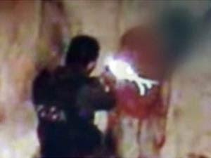 Reprodução da cena de vídeo de câmera de vigilância na qual adolescente é baleado por policial militar (Foto: Repodução/Divulgação)