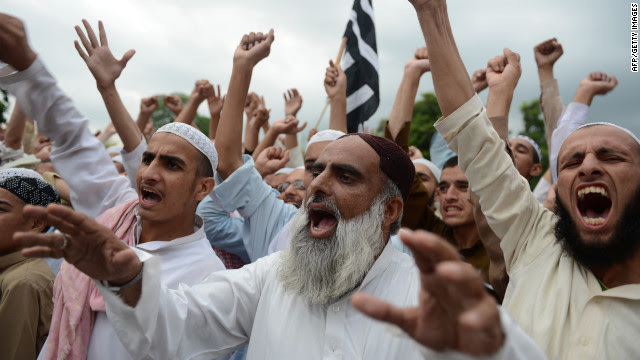Pakistani activists shout slogans in Islamabad on Sunday, September 16.