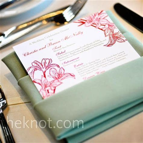 Celadon napkins folded into pockets to hold the white and