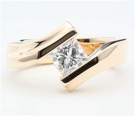 Curved Yellow Gold Tension Set Engagement Ring