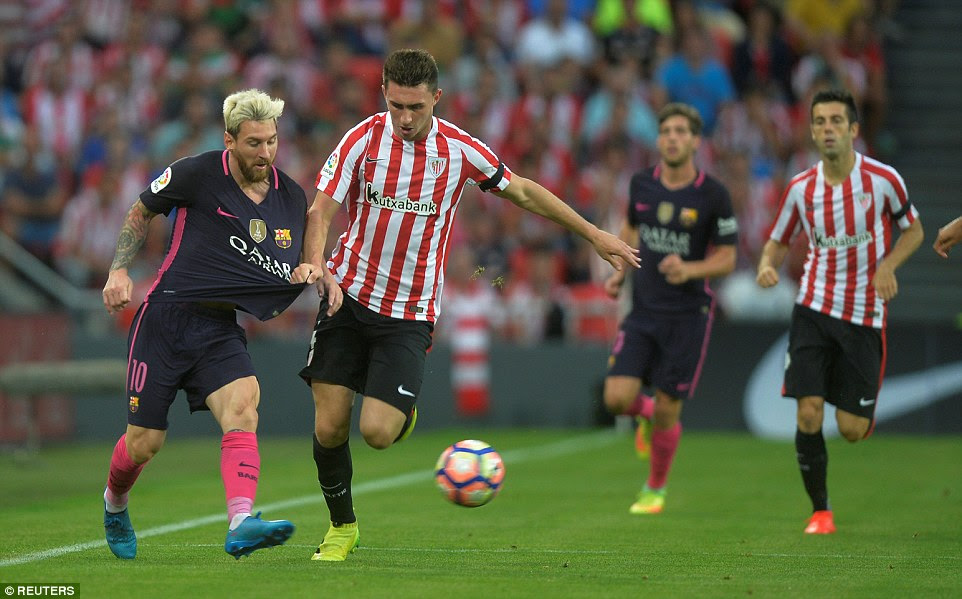 Highly rated centre back Aymeric Laporte (centre) discovers  it's not the easiest task to try and stop Lionel Messi in his tracks